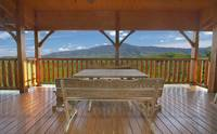 Large wooden deck with picnic table overlooking the mountains at Majestic View Lodge cabin near Pigeon Forge and Gatlinburg