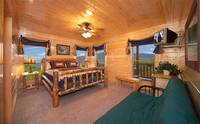 King-size bedroom that overlooks the mountains in Majestic View Lodge cabin in Pigeon Forge