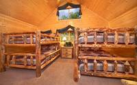 Two sets of queen-size bunk beds in Majestic View Lodge cabin in Pigeon Forge