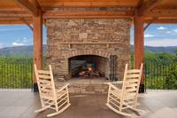 Outdoor pavillion and fireplace at The Preserve Resort overlooking the mountains