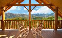 Covered deck with rocking chairs at Cades Cove Castle 8 bedroom cabin in Pigeon Forge