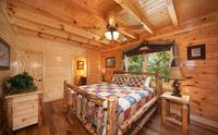 Large king bed in 8 bedroom cabin in Pigeon Forge with private bath