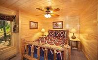 Cades Cove Castle 8 bedroom cabin in Pigeon Forge with king-size bed