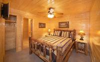 King size bed in Pigeon Forge cabin with 8 bedrooms and flat screen tv