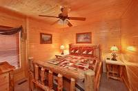 Queen bedroom inside Heavenly Heights 8 bedroom large Pigeon Forge cabin rental
