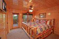 King size suite with tv at Heavenly Heights 8 bedroom large Pigeon Forge cabin rental
