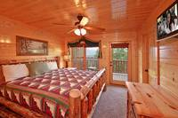 King size suite with tv at Heavenly Heights 8 bedroom cabin rental in Pigeon Forge