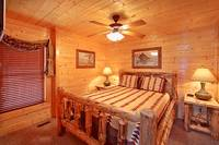 Queen size suite with tv at Heavenly Heights 8 bedroom cabin rental in Pigeon Forge