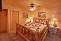 Queen size suite with private bath at Heavenly Heights 8 bedroom cabin rental in Pigeon Forge