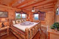 King size suite with private bath at Heavenly Heights 8 bedroom cabin rental in Pigeon Forge