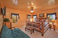 All the bedrooms at Dream View Manor cabin in Pigeon Forge offer scenic Smoky Mountain views