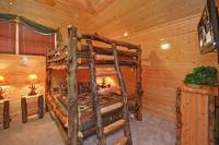 Large double queen size bunk beds inside large Pigeon Forge cabin rental Dream View Manor