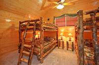 Two sets of queen-size bunk beds at Dream View Manor cabin in Pigeon Forge