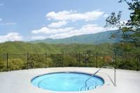 Outdoor hot tub at The Preserve Resort overlooking the mountains