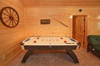 Air hockey table inside Dream View Manor cabin in Pigeon Forge