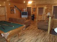 Game room and second living area in Majestic View Lodge cabin in Pigeon Forge