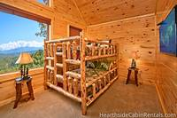 Double queen bunk bedroom with flat-screen tv at Majestic View Lodge
