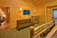 Large king-size bedroom in Majestic View Lodge near upstairs seating area