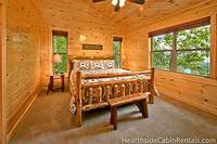 Spacious king-size bedroom in Majestic View Lodge that overlooks the scenic Smoky Mountains