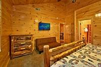 Pigeon Forge cabin rental with 13 bedrooms that have futon, tv and en-suite bath