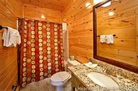 Full private bathroom with shower and vanity at Majestic View Lodge cabin in Pigeon Forge
