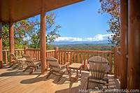 Four patio chairs on covered patio at Majestic View Lodge looking out at the Smoky Mountains