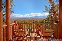 Two chairs on patio overlooking Smoky Mountains at Pigeon Forge cabin rental