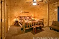 One of the many relaxing bedrooms inside the 16 bedroom cabin in Pigeon Forge