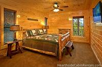 Cozy bedroom at The Big Moose Lodge that overlooks the Smoky Mountains