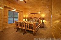 Comfortable bed inside a 16 bedroom Pigeon Forge cabin