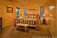 Large log-style Pigeon Forge cabin rental with several king-size suites