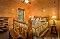 Cozy queen size bedroom at The Big Moose Lodge