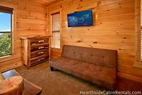 Full-sized futon couch, handmade furniture and flat-screen tv inside large Pigeon Forge cabin