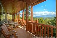 Side view with Smoky Mountains in the distance of the private deck at The Big Moose Lodge
