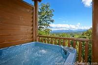 Outdoor hot tub with scenic view at The Big Moose Lodge