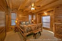 Comfortable king-size bed inside large 8 bedroom cabin in Pigeon Forge