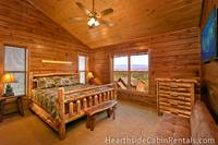 Spacious king-size bedroom with private bath and mountain view inside Pigeon Forge cabin