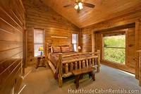 Private king-size suite with mountain view and comfortable furniture in a Pigeon Forge cabin