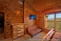 Large Pigeon Forge cabin rental with 8 bedrooms with private bath, futon and mountain views.