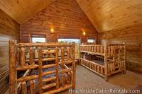 Double queen bunk beds inside Mountain Top Retreat cabin in Pigeon Forge