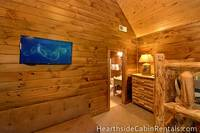 8 bedroom cabin in Pigeon Forge with private bath, flat-screen tv and lofted ceilings.
