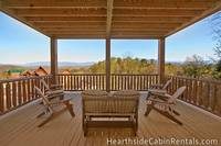 Private deck overlooking the mountains with family seating at Mountain Top Retreat.