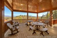Family seating on private deck with mountain views at Pigeon Forge cabin.