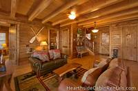 Rustic decor and comfortable furniture inside the Mountain Top Retreat cabin in Pigeon Forge.