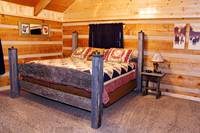 View of a bedroom for relaxing in the Pigeon Forge cabin