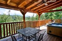 Hot tub and dining area on the back deck