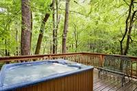 Relax in the hot tub on the deck of this affordable vacation rental