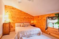 King bed in this 1 bedroom honeymoon cabin in Gatlinburg