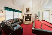 Leather couch, TV, Pool table and gas fireplace