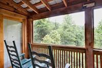 Screened in porch and rocking chairs